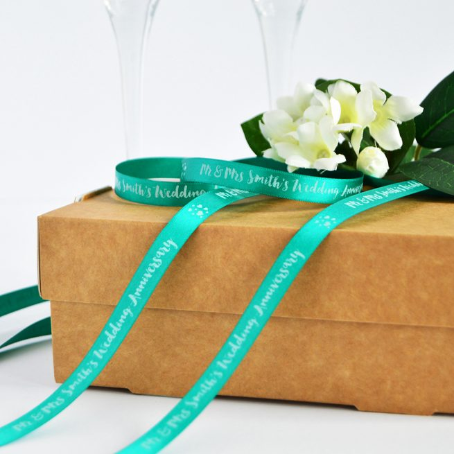 10mm personalised anniversary ribbon in teal with white print