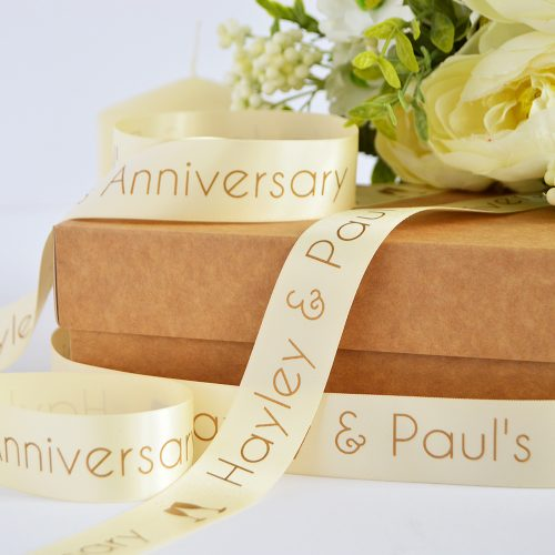 25mm personalised anniversary ribbon in cream with matt antique gold print