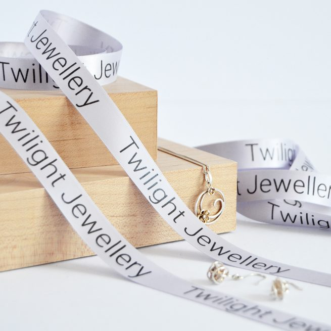 15mm Business Branded Ribbon in light grey with black print