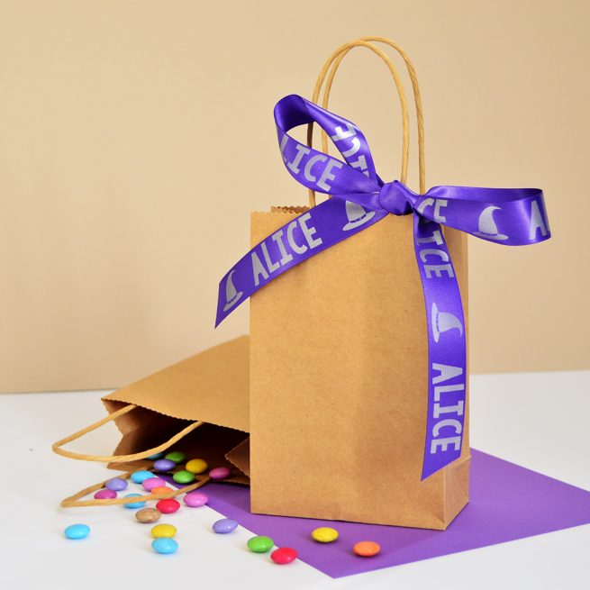 Treat bag with a purple personalised Halloween ribbon bow