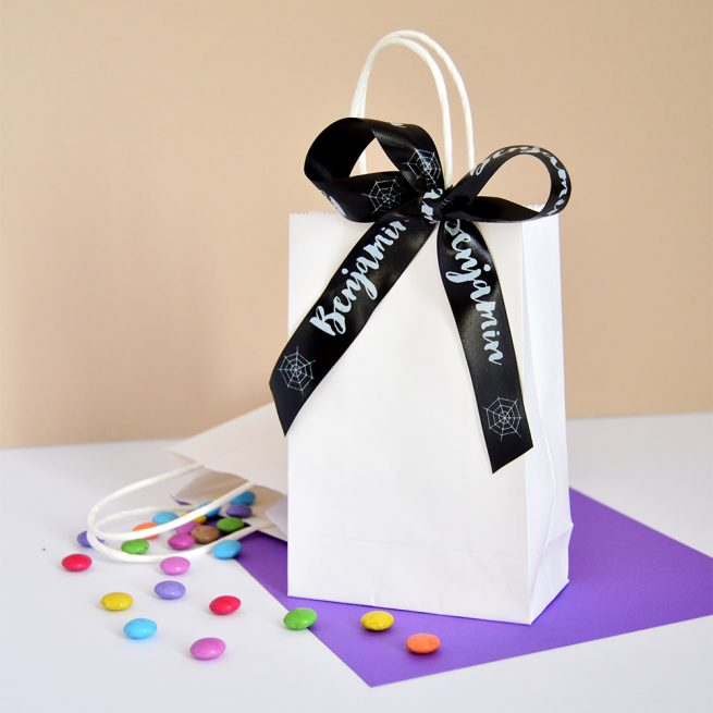 Treat bag with a black personalised Halloween ribbon bow
