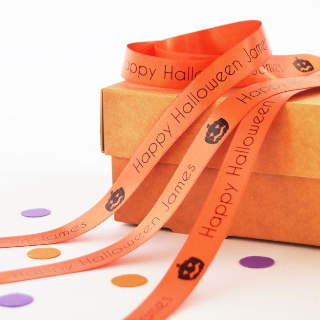 15mm personalised Halloween ribbon in orange with black print