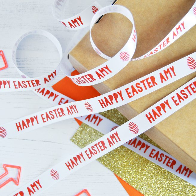 15mm personalised Easter ribbon in white with orange print