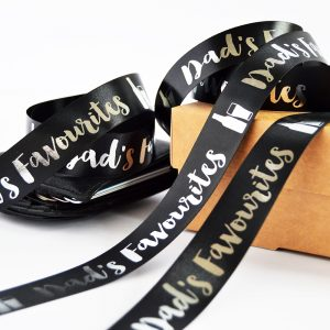 25mm personalised Father's Day ribbon in black with metallic silver printed text and an image of a bottle and glass