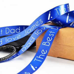 25mm personalised Father's Day ribbon in royal blue with white printed text and a an image of a cricket bat and ball