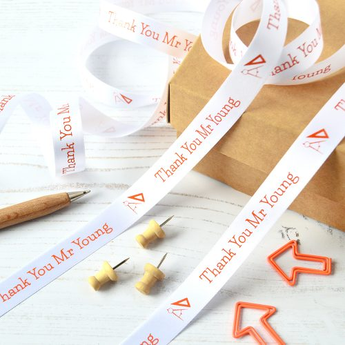 Give your teacher a gift that stands out with our 15mm personalised thank you teacher ribbon. in White with Orange print