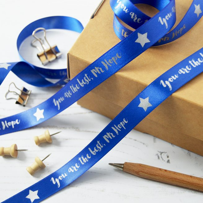 Give your teacher a gift that stands out with our 15mm personalised thank you teacher ribbon. in Royal Blue with Matt Silver print