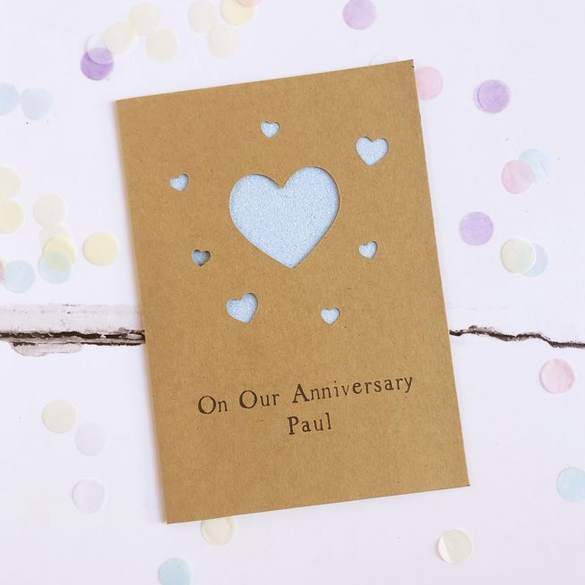 Personalised Anniversary Hearts Glitter Cut Out Card in Kraft and Pastel Blue Glitter