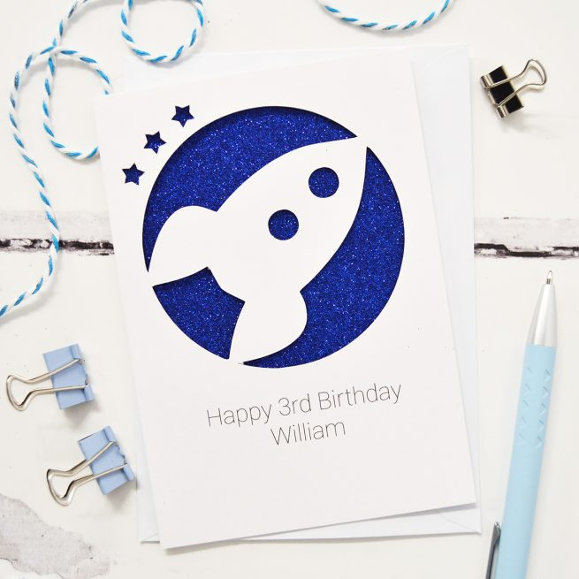 Personalised Rocket Glitter Cut Out Card in White and Blue Glitter